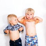 Older sibling and cousin having fun at bump shoot