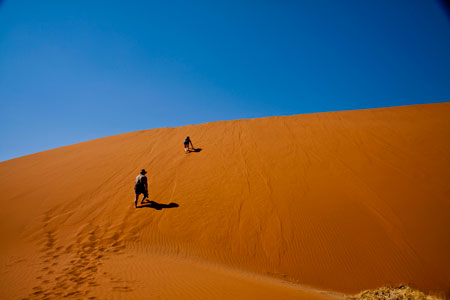Climbing the dune near Deadvlei, Sossusvlei, Namibia