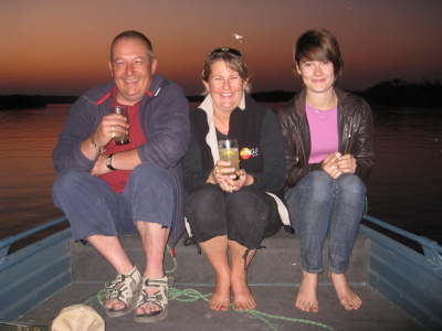 Sundowners with my husband Chris and daughter Sophie on the Okavango River, Botswana